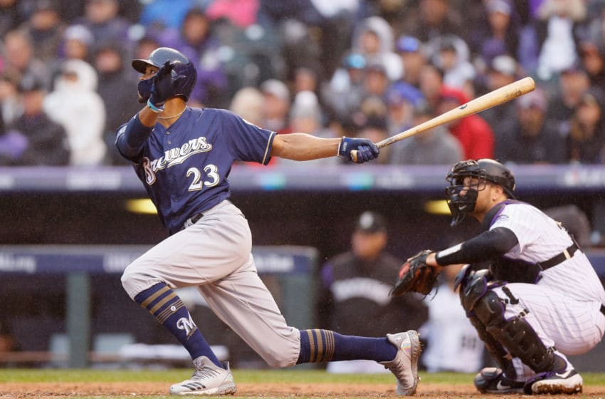DENVER, CO - OCTOBER 07: Keon Broxton #23 of the Milwaukee Brewers hits a solo homerun in the ninth inning of Game Three of the National League Division Series against the Colorado Rockies at Coors Field on October 7, 2018 in Denver, Colorado. (Photo by Justin Edmonds/Getty Images)
