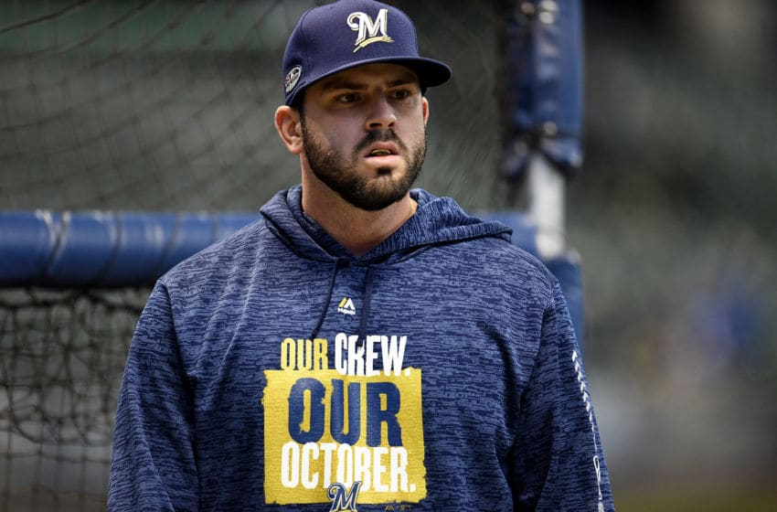 MILWAUKEE, WI - OCTOBER 12: Mike Moustakas #18 of the Milwaukee Brewers looks on prior to Game One of the National League Championship Series against the Los Angeles Dodgers at Miller Park on October 12, 2018 in Milwaukee, Wisconsin. (Photo by Stacy Revere/Getty Images)