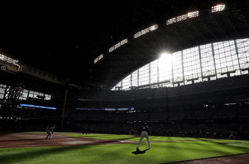 MILWAUKEE, WI - OCTOBER 13: Ryan Braun #8 of the Milwaukee Brewers bats against the Los Angeles Dodgers during the first inning in Game Two of the National League Championship Series at Miller Park on October 13, 2018 in Milwaukee, Wisconsin. (Photo by Rob Carr/Getty Images)
