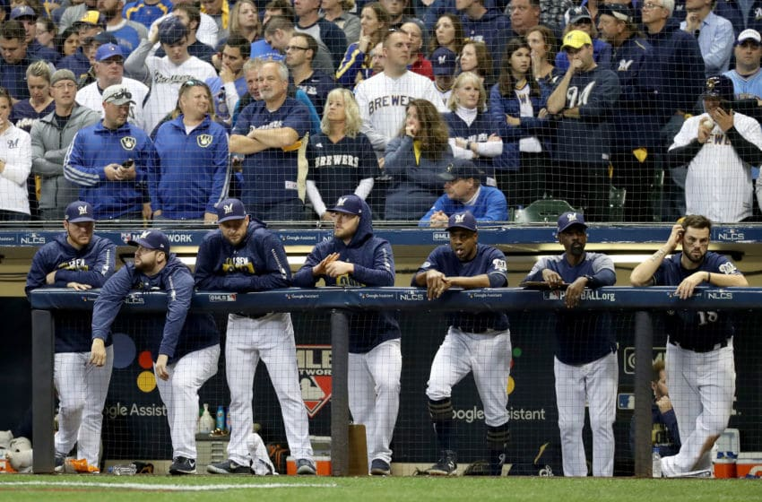 MILWAUKEE, WI - OCTOBER 13: The Milwaukee Brewers dugout looks on against the Los Angeles Dodgers during the ninth inning in Game Two of the National League Championship Series at Miller Park on October 13, 2018 in Milwaukee, Wisconsin. (Photo by Rob Carr/Getty Images)