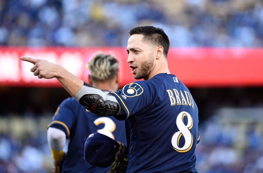LOS ANGELES, CA - OCTOBER 15: Ryan Braun #8 of the Milwaukee Brewers points to the dugout from first base after the first half of the first inning during Game Three of the National League Championship Series against the Los Angeles Dodgers at Dodger Stadium on October 15, 2018 in Los Angeles, California. (Photo by Kevork Djansezian/Getty Images)