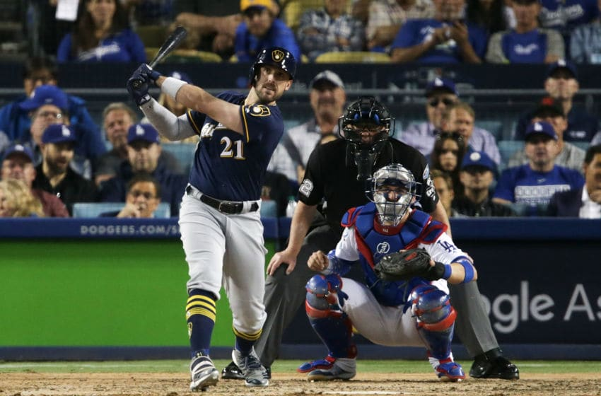 LOS ANGELES, CA - OCTOBER 15: Travis Shaw #21 of the Milwaukee Brewers hits a triple in the sixth inning against the Los Angeles Dodgers in Game Three of the National League Championship Series at Dodger Stadium on October 15, 2018 in Los Angeles, California. (Photo by Jeff Gross/Getty Images)