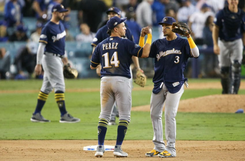 LOS ANGELES, CA - OCTOBER 15: Orlando Arcia #3 and Hernan Perez #14 of the Milwaukee Brewers celebrate after defeating the Los Angeles Dodgers 4-0 in Game Three of the National League Championship Series at Dodger Stadium on October 15, 2018 in Los Angeles, California. (Photo by Jeff Gross/Getty Images)
