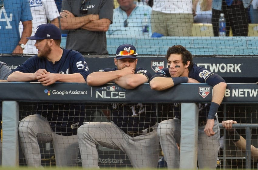 LOS ANGELES, CA - OCTOBER 17: Christian Yelich #22 of the Milwaukee Brewers and his teammates react during the ninth inning against the Los Angeles Dodgers in Game Five of the National League Championship Series at Dodger Stadium on October 17, 2018 in Los Angeles, California. (Photo by Kevork Djansezian/Getty Images)