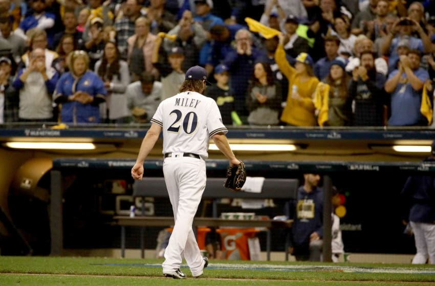 MILWAUKEE, WI - OCTOBER 19: Wade Miley #20 of the Milwaukee Brewers is relieved by manager Craig Counsell #30 against the Los Angeles Dodgers during the fifth inning in Game Six of the National League Championship Series at Miller Park on October 19, 2018 in Milwaukee, Wisconsin. (Photo by Jonathan Daniel/Getty Images)