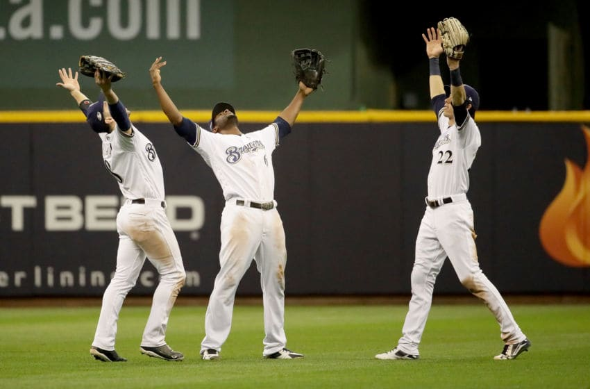 MILWAUKEE, WI - OCTOBER 19: Ryan Braun #8, Lorenzo Cain #6 and Christian Yelich #22 of the Milwaukee Brewers celebrate after defeating the Los Angeles Dodgers in Game Six of the National League Championship Series at Miller Park on October 19, 2018 in Milwaukee, Wisconsin. (Photo by Jonathan Daniel/Getty Images)