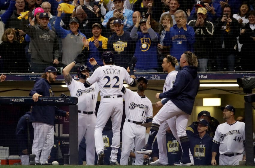 MILWAUKEE, WI - OCTOBER 20: Christian Yelich #22 of the Milwaukee Brewers celebrates after hitting a solo home run against Walker Buehler #21 of the Los Angeles Dodgers during the first inning in Game Seven of the National League Championship Series at Miller Park on October 20, 2018 in Milwaukee, Wisconsin. (Photo by Jonathan Daniel/Getty Images)