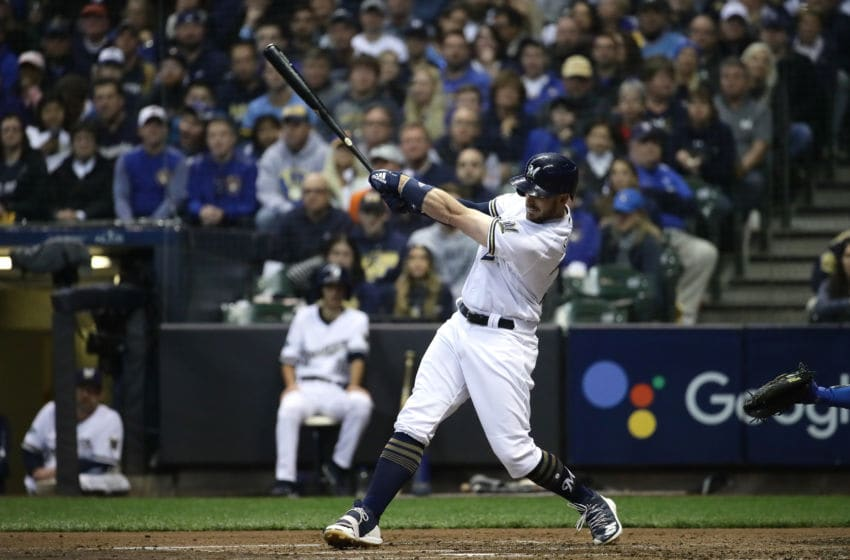 MILWAUKEE, WI - OCTOBER 20: Travis Shaw #21 of the Milwaukee Brewers hits a double missed by Yasiel Puig #66 of the Los Angeles Dodgers during the fourth inning in Game Seven of the National League Championship Series at Miller Park on October 20, 2018 in Milwaukee, Wisconsin. (Photo by Jonathan Daniel/Getty Images)