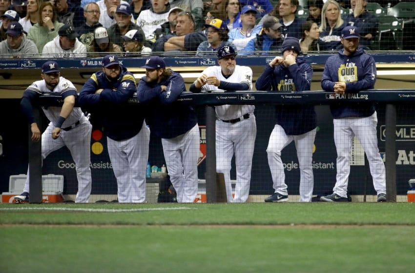 MILWAUKEE, WI - OCTOBER 20: The Milwaukee Brewers look on from the dugout during the ninth inning against the Los Angeles Dodgers in Game Seven of the National League Championship Series at Miller Park on October 20, 2018 in Milwaukee, Wisconsin. (Photo by Jonathan Daniel/Getty Images)