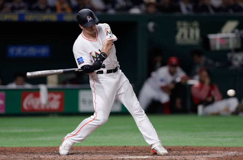 TOKYO, JAPAN - NOVEMBER 10: Catcher J.T. Realmuto #11 of the Miami Marlins hits a double in the bottom of 7th inning during the game two of the Japan and MLB All Stars at Tokyo Dome on November 10, 2018 in Tokyo, Japan. (Photo by Kiyoshi Ota/Getty Images)