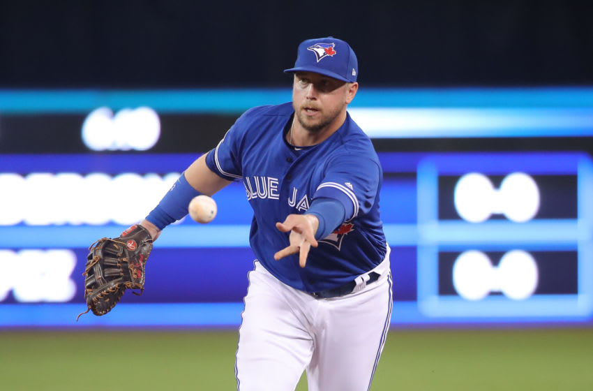 TORONTO, ON - MARCH 30: Justin Smoak #14 of the Toronto Blue Jays flips the ball to the pitcher covering first base after fielding a grounder to get the baserunner at first base in the fourth inning during MLB game action against the Detroit Tigers at Rogers Centre on March 30, 2019 in Toronto, Canada. (Photo by Tom Szczerbowski/Getty Images)