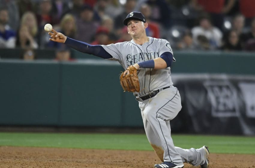 ANAHEIM, CA - APRIL 18: Ryon Healy #27 of the Seattle Mariners makes a throw to first base to catch David Fletcher #6 of the Los Angeles Angels of Anaheim for the final out of the game at Angel Stadium of Anaheim on April 18, 2019 in Anaheim, California. Mariners won 11-10. (Photo by John McCoy/Getty Images)