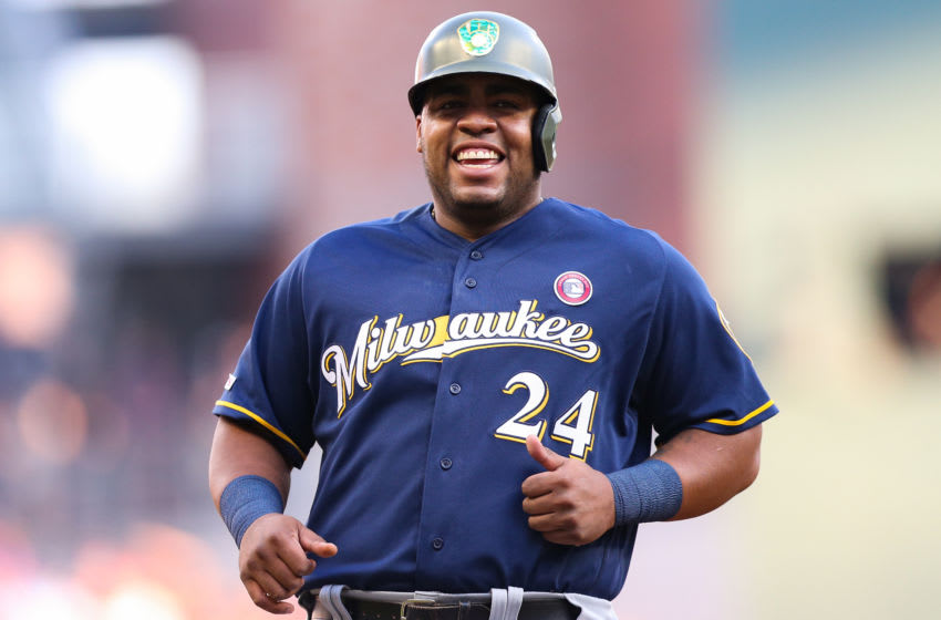 ATLANTA, GA - MAY 18: Jesus Aguilar #24 of the Milwaukee Brewers runs to third base in the first inning during the game against the Atlanta Braves at SunTrust Park on May 18, 2019 in Atlanta, Georgia. (Photo by Carmen Mandato/Getty Images)
