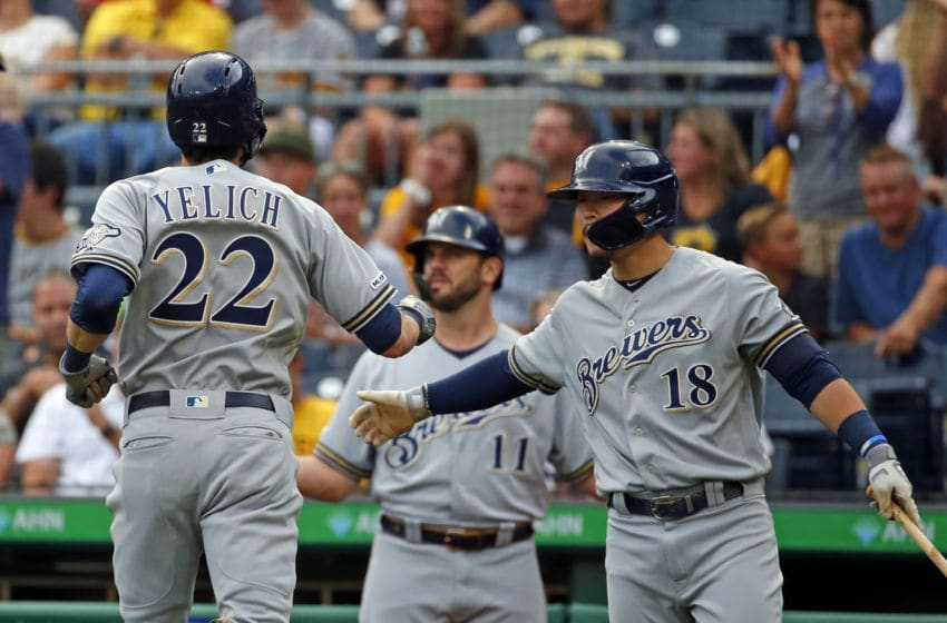 PITTSBURGH, PA - AUGUST 05: Christian Yelich #22 of the Milwaukee Brewers celebrates with Keston Hiura #18 after hitting a home run in the first inning against the Pittsburgh Pirates at PNC Park on August 5, 2019 in Pittsburgh, Pennsylvania. (Photo by Justin K. Aller/Getty Images)