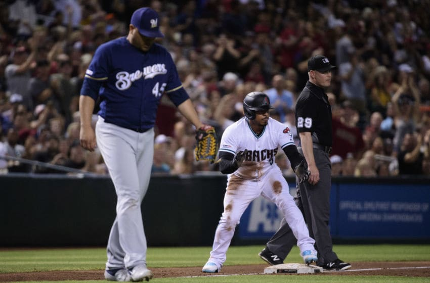 PHOENIX, ARIZONA - JULY 19: Eduardo Escobar #5 of the Arizona Diamondbacks celebrates an RBI triple against Jhoulys Chacin #45 of the Milwaukee Brewers in the third inning of the MLB game at Chase Field on July 19, 2019 in Phoenix, Arizona. (Photo by Jennifer Stewart/Getty Images)