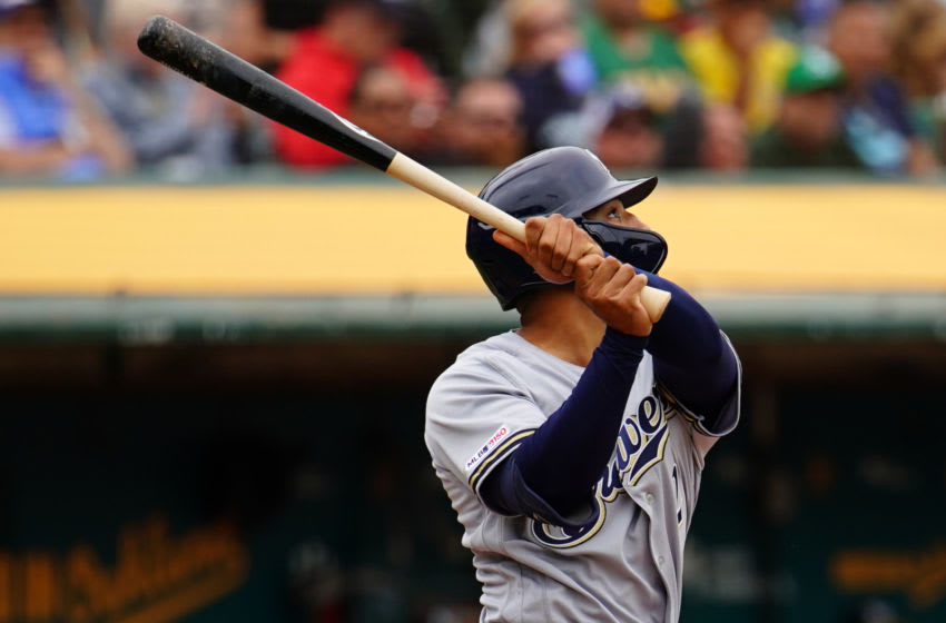 OAKLAND, CALIFORNIA - AUGUST 01: Trent Grisham #2 of the Milwaukee Brewers hits an RBI sacrifice fly during the fourth inning against the Oakland Athletics at Ring Central Coliseum on August 01, 2019 in Oakland, California. (Photo by Daniel Shirey/Getty Images)