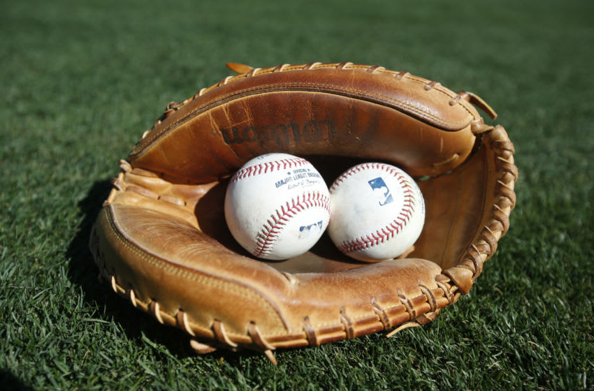 OAKLAND, CA - AUGUST 15: A glove and pair of baseballs sit on the field prior to the game between the Oakland Athletics and the Houston Astros at the Oakland-Alameda County Coliseum on August 15, 2019 in Oakland, California. The Athletics defeated the Astros 7-6. (Photo by Michael Zagaris/Oakland Athletics/Getty Images)