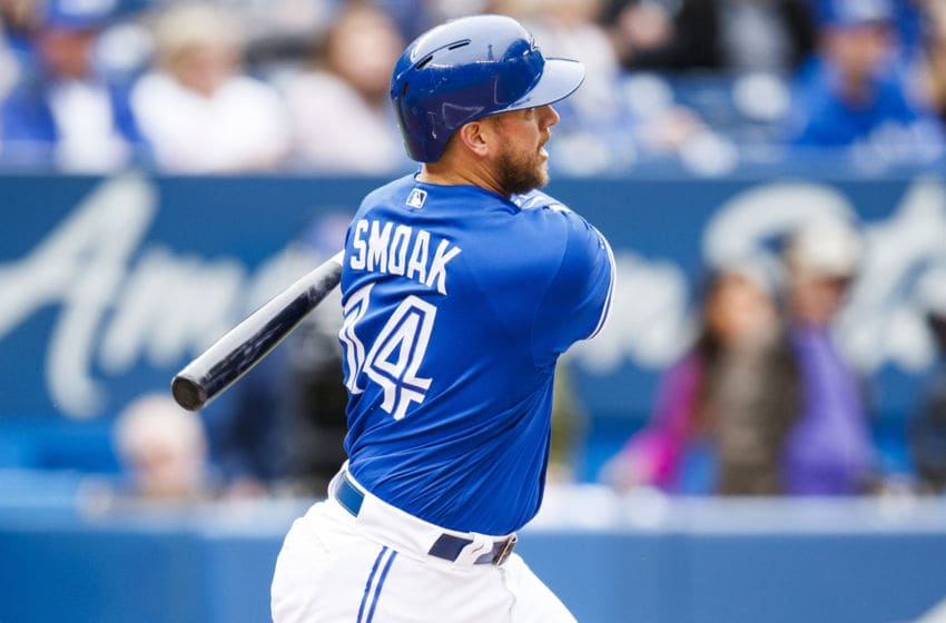 TORONTO, ONTARIO - SEPTEMBER 29: Justin Smoak #14 of the Toronto Blue Jays hits a two-run double against the Tampa Bay Rays in the first inning at the Rogers Centre on September 29, 2019 in Toronto, Canada. (Photo by Mark Blinch/Getty Images)