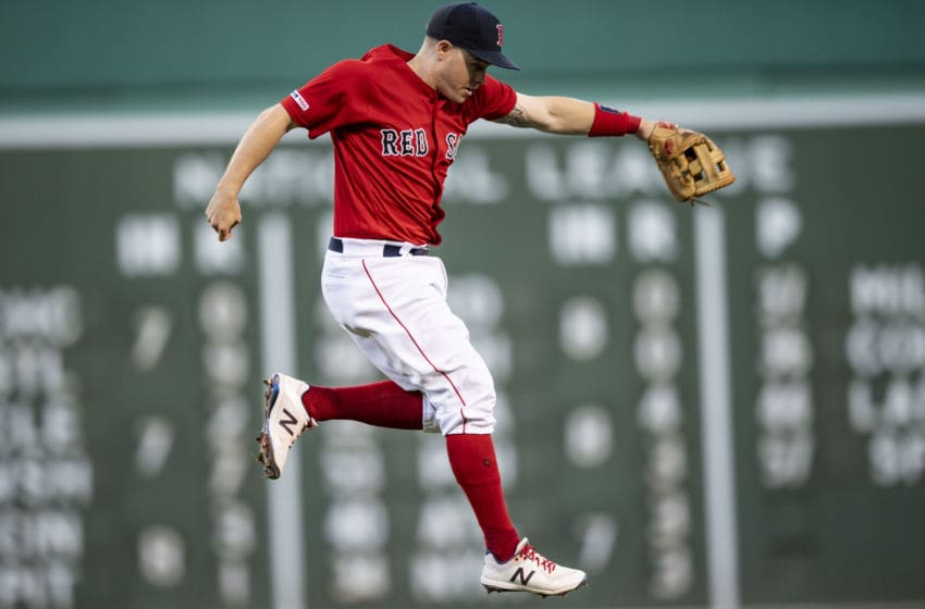 BOSTON, MA - SEPTEMBER 29: Brock Holt #12 of the Boston Red Sox attempts to catch a line drive during the eighth inning of a game against the Baltimore Orioles on September 29, 2019 at Fenway Park in Boston, Massachusetts. (Photo by Billie Weiss/Boston Red Sox/Getty Images)