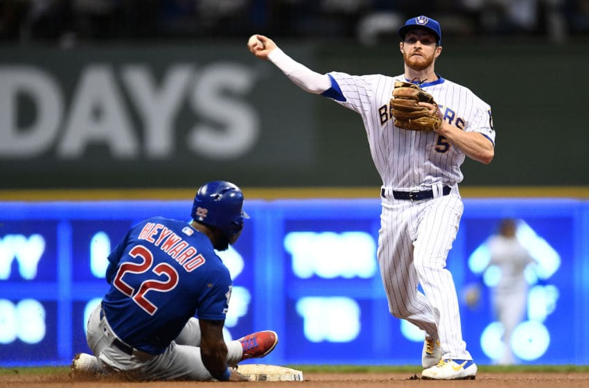 MILWAUKEE, WISCONSIN - SEPTEMBER 06: Jason Heyward #22 of the Chicago Cubs is forced out at second base as Cory Spangenberg #5 of the Milwaukee Brewers makes a throw to first base during the eighth inning at Miller Park on September 06, 2019 in Milwaukee, Wisconsin. (Photo by Stacy Revere/Getty Images)