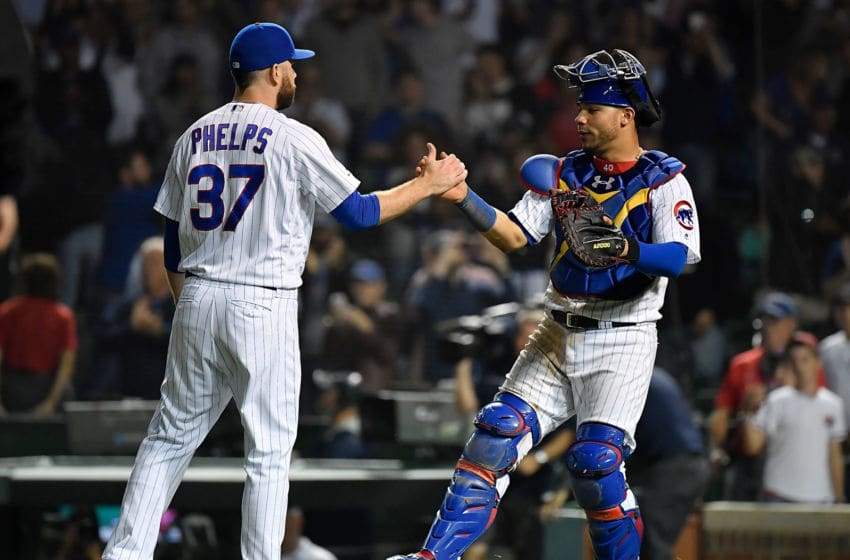 CHICAGO, ILLINOIS - SEPTEMBER 16: David Phelps #37 and Willson Contreras #40 of the Chicago Cubs shake hands after defeating the Cincinnati Reds at Wrigley Field on September 16, 2019 in Chicago, Illinois. (Photo by Quinn Harris/Getty Images)