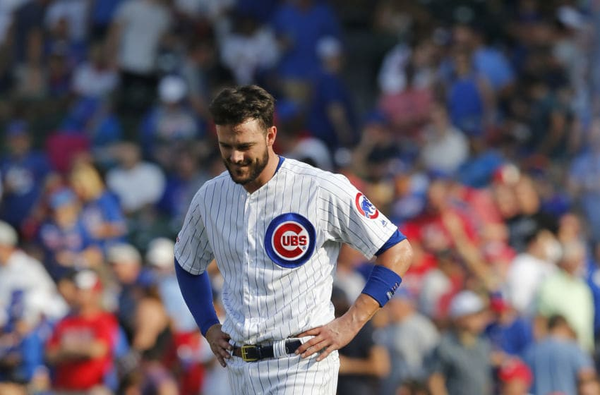 CHICAGO, ILLINOIS - SEPTEMBER 20: Kris Bryant #17 of the Chicago Cubs reacts after his fly out with the bases loaded during the seventh inning of a game against the St. Louis Cardinals at Wrigley Field on September 20, 2019 in Chicago, Illinois. (Photo by Nuccio DiNuzzo/Getty Images)