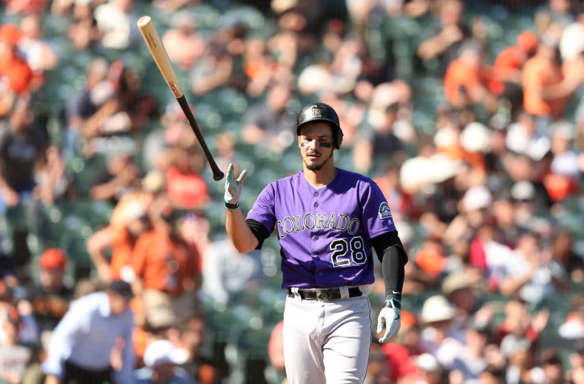 SAN FRANCISCO, CALIFORNIA - SEPTEMBER 26: Nolan Arenado #28 of the Colorado Rockies tosses his bat after he struck out to end the seven inning against the San Francisco Giants at Oracle Park on September 26, 2019 in San Francisco, California. (Photo by Ezra Shaw/Getty Images)