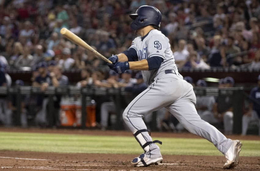 PHOENIX, ARIZONA - SEPTEMBER 28: Luis Urias #9 of the San Diego Padres hits an RBI single in the sixth inning of the MLB game against the Arizona Diamondbacks at Chase Field on September 28, 2019 in Phoenix, Arizona. (Photo by Jennifer Stewart/Getty Images)