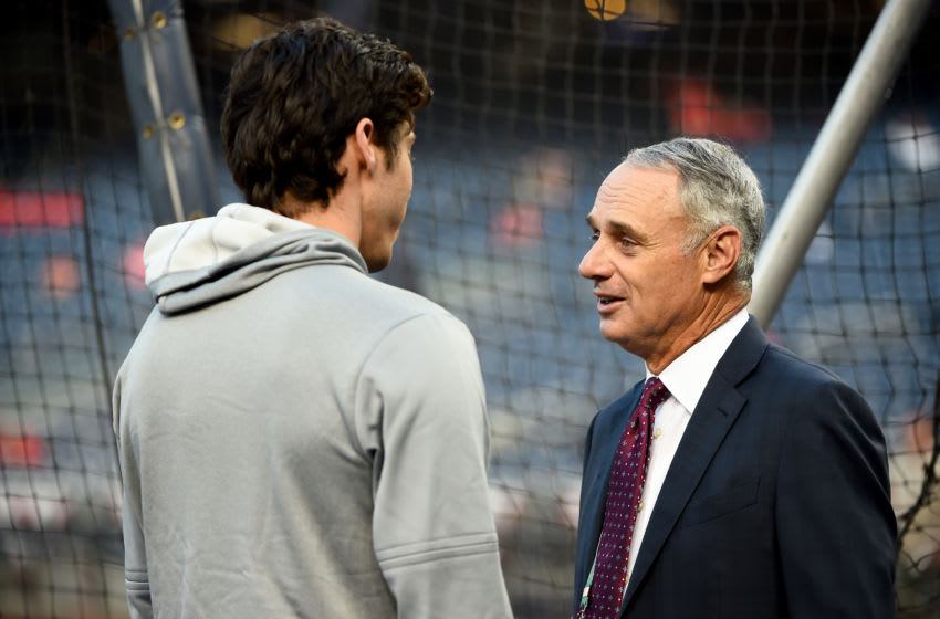 WASHINGTON, DC - OCTOBER 01: (L-R) Christian Yelich #22 of the Milwaukee Brewers talks with Rob Manfred, Commissioner of the Major League Baseball during batting practice prior to the National League Wild Card game against the Washington Nationals at Nationals Park on October 01, 2019 in Washington, DC. (Photo by Will Newton/Getty Images)
