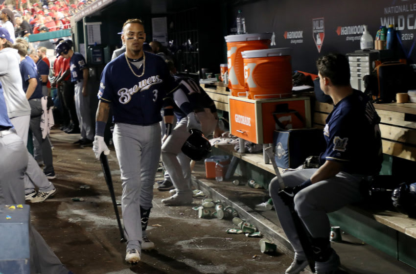 WASHINGTON, DC - OCTOBER 01: Orlando Arcia #3 of the Milwaukee Brewers reacts in the dugout after fouling out against the Washington Nationals during the ninth inning in the National League Wild Card game at Nationals Park on October 01, 2019 in Washington, DC. (Photo by Rob Carr/Getty Images)