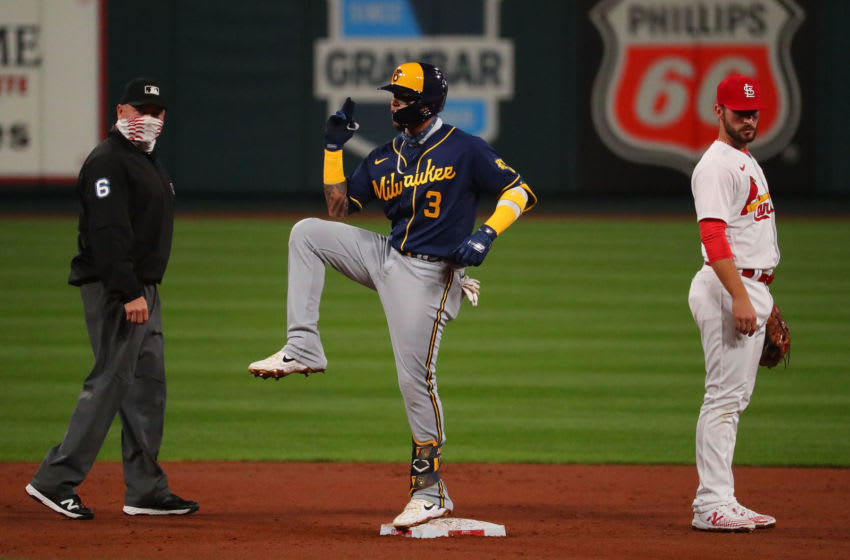 ST LOUIS, MO - SEPTEMBER 24: Orlando Arcia #3 of the Milwaukee Brewers celebrates after hitting a double against the St. Louis Cardinals as Mark Carlson #6 and Paul DeJong #11 of the St. Louis Cardinals look on in the third inning at Busch Stadium on September 24, 2020 in St Louis, Missouri. (Photo by Dilip Vishwanat/Getty Images)