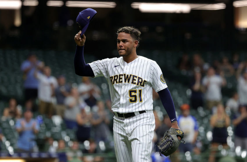 MILWAUKEE, WISCONSIN - JUNE 04: Freddy Peralta #51 of the Milwaukee Brewers waves to the crowd after coming out of the game in the eighth inning against the Arizona Diamondbacks at American Family Field on June 04, 2021 in Milwaukee, Wisconsin. (Photo by Stacy Revere/Getty Images)
