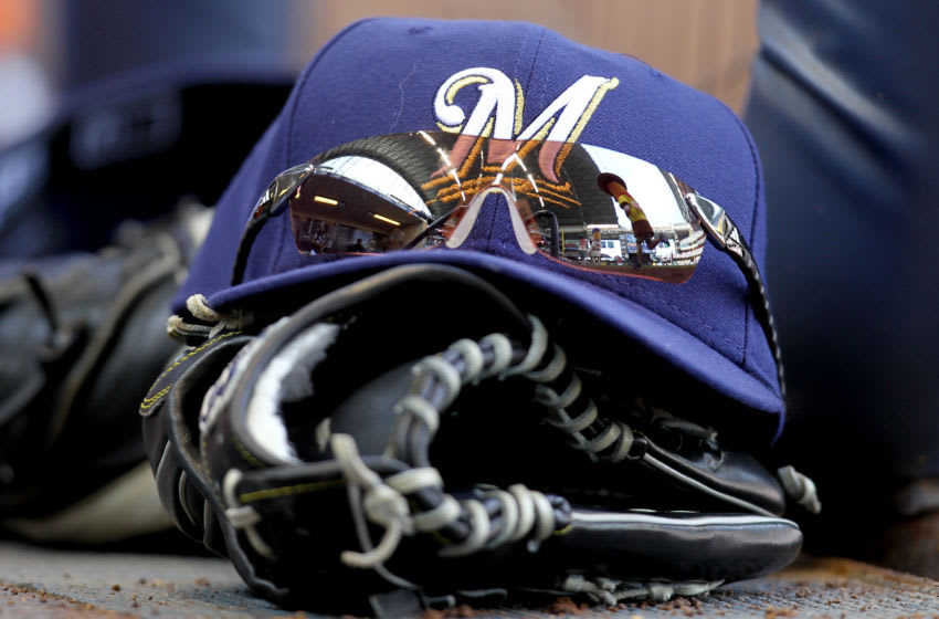 MILWAUKEE, WI - MAY 23: Norichika Aoki's of the Milwaukee Brewers sunglasses, cap and glove sit on the steps on the Brewers dugout during during the sausage races in the game against the San Francisco Giants at Miller Park on May 23, 2012 in Milwaukee, Wisconsin. (Photo by Mike McGinnis/Getty Images)