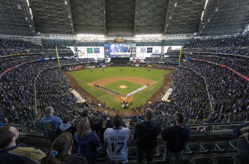 MILWAUKEE, WI - APRIL 1: General view of the Colorado Rockies and Milwaukee Brewers line the base lines during the National Anthem on opening day at Miller Park on April 1, 2013 in Milwaukee, Wisconsin. (Photo by Tom Lynn/Getty Images)