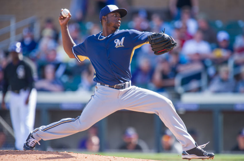 SCOTTSDALE, AZ - MARCH 2: Alfredo Figaro #45 of the Milwaukee Brewers pitches during a spring training game against the Colorado Rockies at Salt River Fields at Talking Stick on March 2, 2014 in Scottsdale, Arizona. (Photo by Rob Tringali/Getty Images)