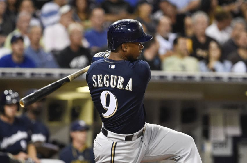 SAN DIEGO, CA - SEPTEMBER 30: Jean Segura #9 of the Milwaukee Brewers hits an RBI single during the sixth inning of a baseball game against the San Diego Padres at Petco Park September 30, 2015 in San Diego, California. (Photo by Denis Poroy/Getty Images)