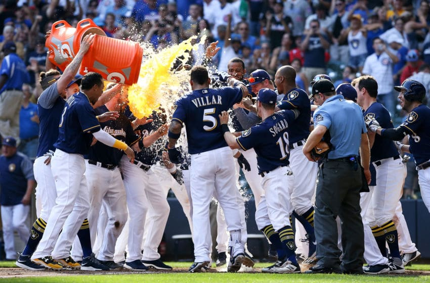 MILWAUKEE, WI - SEPTEMBER 23: The Milwaukee Brewers celebrate after Travis Shaw #21 hit a walk off home run to beat the Chicago Cubs 4-3 in ten innings at Miller Park on September 23, 2017 in Milwaukee, Wisconsin. (Photo by Dylan Buell/Getty Images)