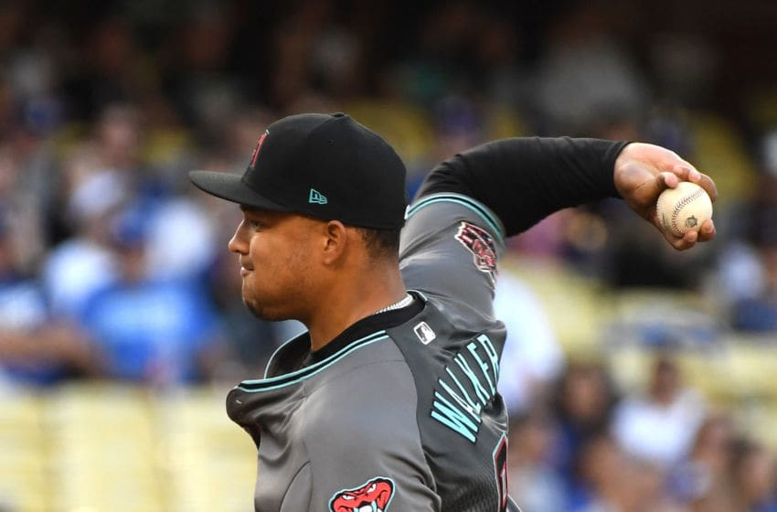 LOS ANGELES, CA - APRIL 14: Taijuan Walker #99 of the Arizona Diamondbacks pitches in the first inning of the game against the Los Angeles Dodgers at Dodger Stadium on April 14, 2018 in Los Angeles, California. (Photo by Jayne Kamin-Oncea/Getty Images)