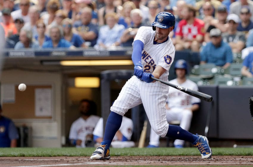 MILWAUKEE, WI - JUNE 16: Travis Shaw #21 of the Milwaukee Brewers hits a single in the first inning against the Philadelphia Phillies at Miller Park on June 16, 2018 in Milwaukee, Wisconsin. (Photo by Dylan Buell/Getty Images)