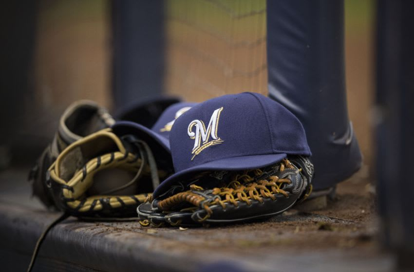 MILWAUKEE, WI - APRIL 7: Milwaukee Brewers ball cap and gloves are left on the dugout steps during the game against the San Francisco Giants at Miller Park on April 18, 2013 in Milwaukee, Wisconsin. (Photo by Tom Lynn/Getty Images)