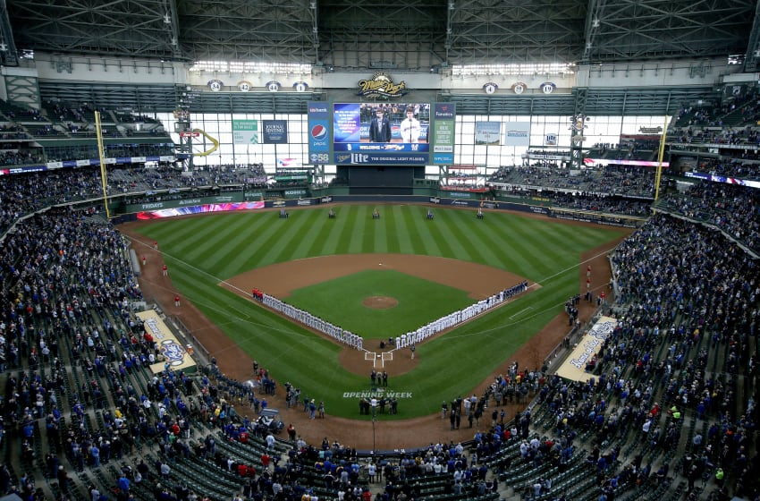 MILWAUKEE, WI - APRIL 02: The St. Louis Cardinals and Milwaukee Brewers stand for the singing of the national anthem before the game at Miller Park on April 2, 2018 in Milwaukee, Wisconsin. (Photo by Dylan Buell/Getty Images)