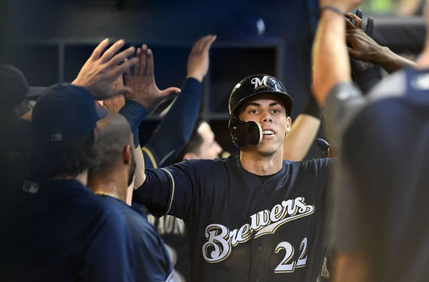 MILWAUKEE, WI - JULY 24: Christian Yelich #22 of the Milwaukee Brewers is congratulated by teammates following a two run home run against the Washington Nationals during the fifth inning of a game at Miller Park on July 24, 2018 in Milwaukee, Wisconsin. (Photo by Stacy Revere/Getty Images)