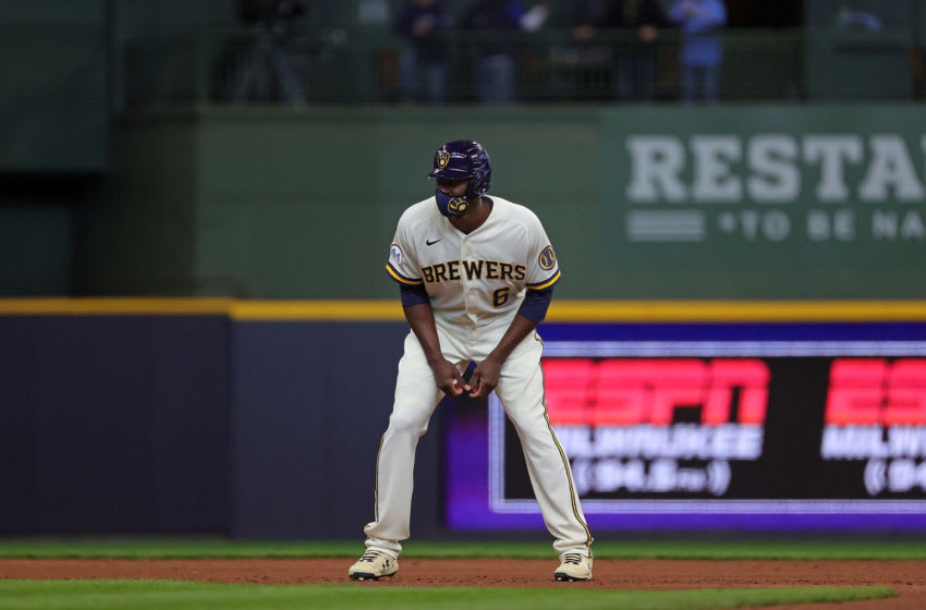 MILWAUKEE, WISCONSIN - APRIL 01: Lorenzo Cain #6 of the Milwaukee Brewers takes a lead from second base during a game against the Minnesota Twins on Opening Day at American Family Field on April 01, 2021 in Milwaukee, Wisconsin. The Brewers defeated the Twins 6-5. (Photo by Stacy Revere/Getty Images)