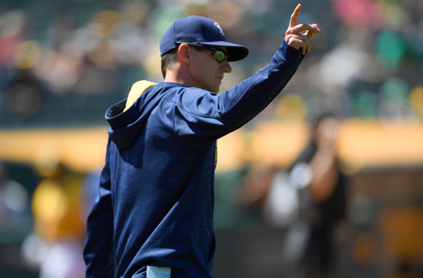 OAKLAND, CA - JUNE 22: Manager Craig Counsell #30 of the Milwaukee Brewers signals the bullpen to make a pitching change against the Oakland Athletics in the bottom of the eighth inning at O.co Coliseum on June 22, 2016 in Oakland, California. (Photo by Thearon W. Henderson/Getty Images)