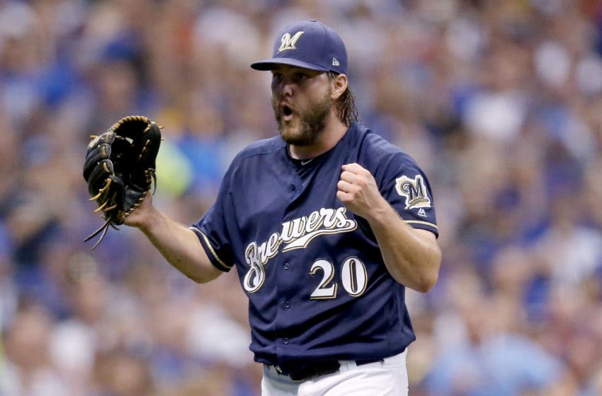 MILWAUKEE, WI - SEPTEMBER 04: Wade Miley #20 of the Milwaukee Brewers reacts in the sixth inning against the Chicago Cubs at Miller Park on September 4, 2018 in Milwaukee, Wisconsin. (Photo by Dylan Buell/Getty Images)