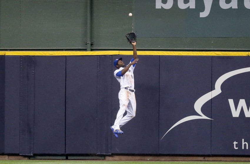 MILWAUKEE, WI - SEPTEMBER 14: Lorenzo Cain #6 of the Milwaukee Brewers leaps to catch a fly ball in the second inning against the Pittsburgh Pirates at Miller Park on September 14, 2018 in Milwaukee, Wisconsin. (Photo by Dylan Buell/Getty Images)
