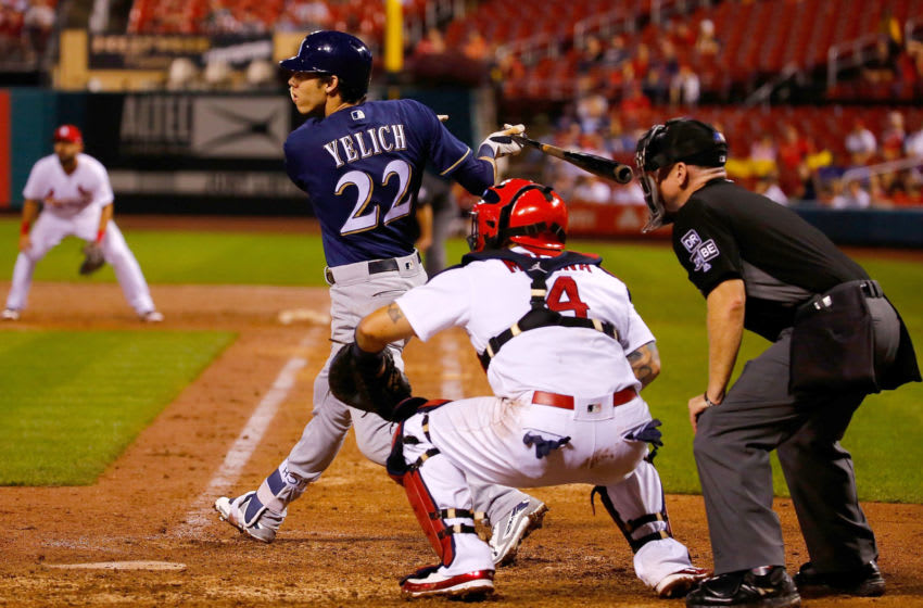 ST. LOUIS, MO - SEPTEMBER 24: Christian Yelich #22 of the Milwaukee Brewers hits an RBI double against the St. Louis Cardinals in the ninth inning at Busch Stadium on September 24, 2018 in St. Louis, Missouri. (Photo by Dilip Vishwanat/Getty Images)