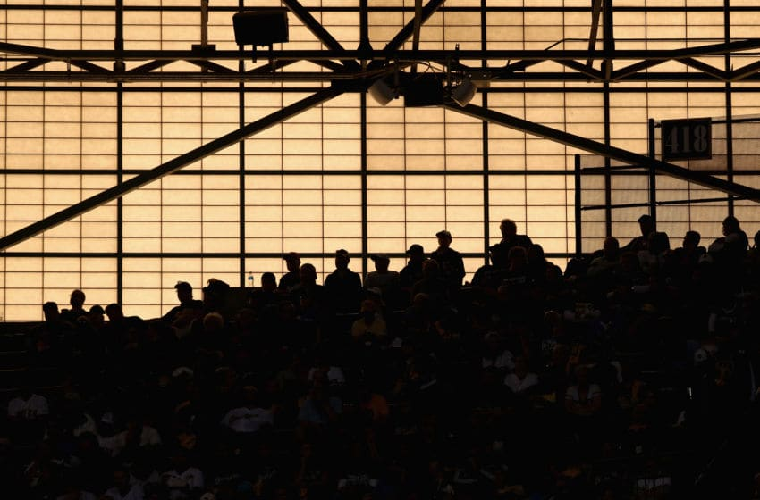 MILWAUKEE, WI - OCTOBER 04: Fans are seen as the sun sets during Game One of the National League Division Series between the Colorado Rockies and Milwaukee Brewers at Miller Park on October 4, 2018 in Milwaukee, Wisconsin. (Photo by Dylan Buell/Getty Images)