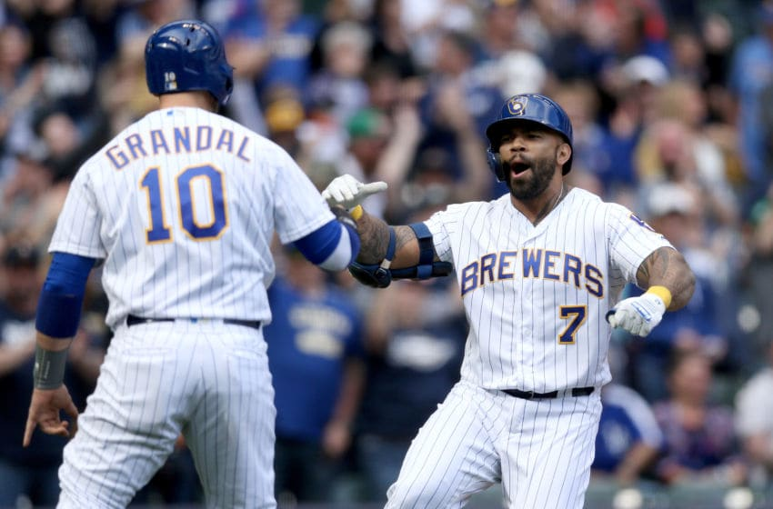 MILWAUKEE, WISCONSIN - APRIL 21: Yasmani Grandal #10 and Eric Thames #7 of the Milwaukee Brewers celebrate after Thames hit a home run in the eighth inning against the Los Angeles Dodgers at Miller Park on April 21, 2019 in Milwaukee, Wisconsin. (Photo by Dylan Buell/Getty Images)