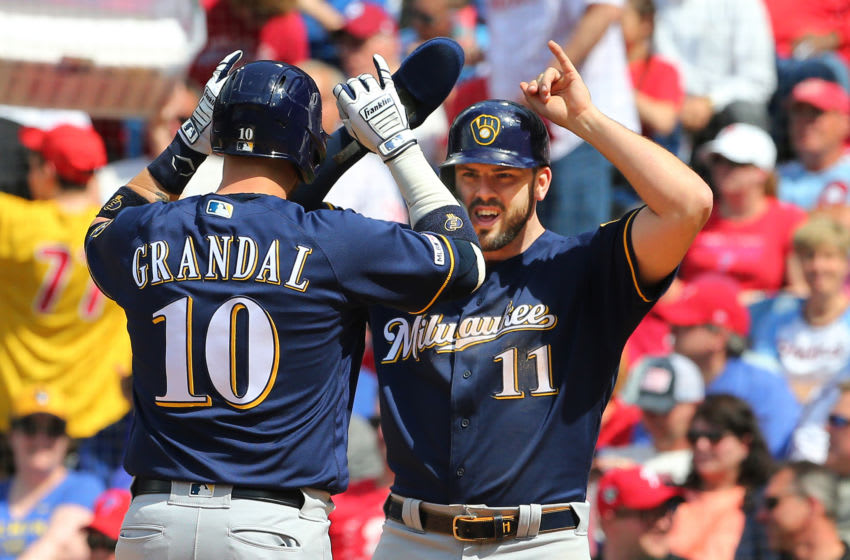 PHILADELPHIA, PA - MAY 16: Yasmani Grandal #10 of the Milwaukee Brewers celebrates with Mike Moustakas #11 after he hit a two-run home run during the seventh inning of a game against the Philadelphia Phillies at Citizens Bank Park on May 16, 2019 in Philadelphia, Pennsylvania. The Brewers defeated the Phillies 11-3. (Photo by Rich Schultz/Getty Images)